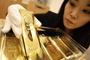 超級富豪忙著避險 黃金 美元 港幣 台幣大混戰