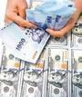 新台幣午盤貶1.4分 暫收30.514元